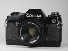 WITHDRAWN A Contax 137 md Quartz SLR 35mm camera, together with a Yashica 55mm f2 lens
