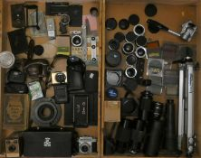 A collection of cameras and accessories, including brands such as Kodak, Ilford and Canon