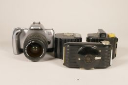 A Canon EOS 300V SLR Film Camera w/ Sigma 28-70mm F/2.8-4 Lens, together with a Kodak Bullet