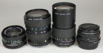 Four camera lenses, including a Pentax-M 28mm F/3.5 Lens w/ Original Lens Caps, together with a