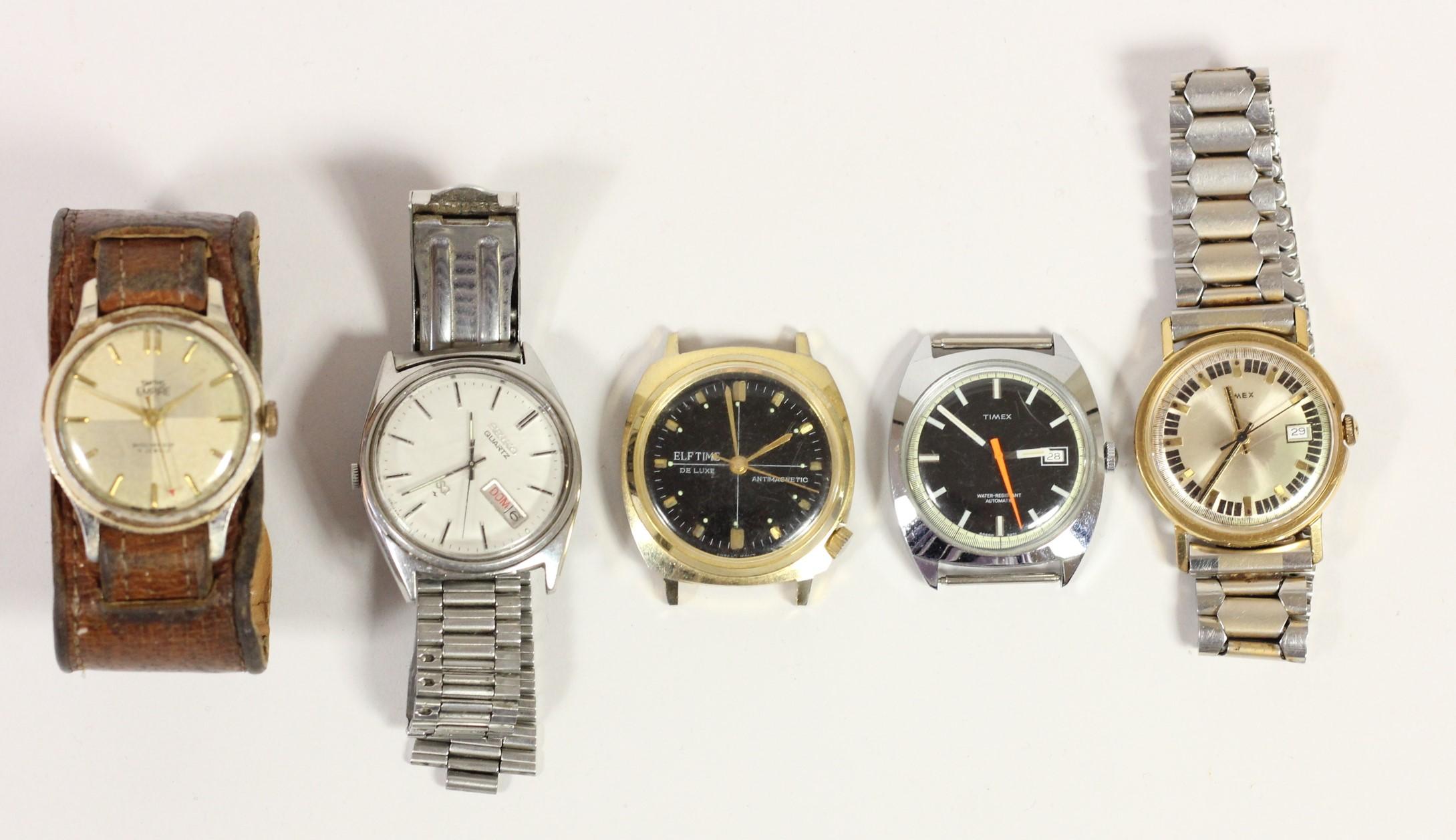 A Smiths Empire manual wind wristwatch, a Seiko quartz day/date wristwatch and three other