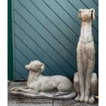 A composite garden figure depicting a seated greyhound / whippet, together with a similar