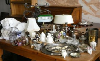 A box of plateware to include, candelabra, serving trays, loose cutlery, together with table