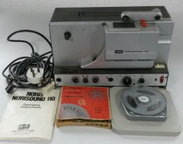 A Noris projector 110 complete with spools, film and instructions.