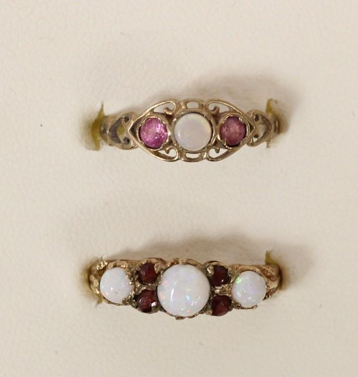 A 9ct gold opal and garnet three stone ring, Q, and a 9ct gold opal ring, N, 3gm