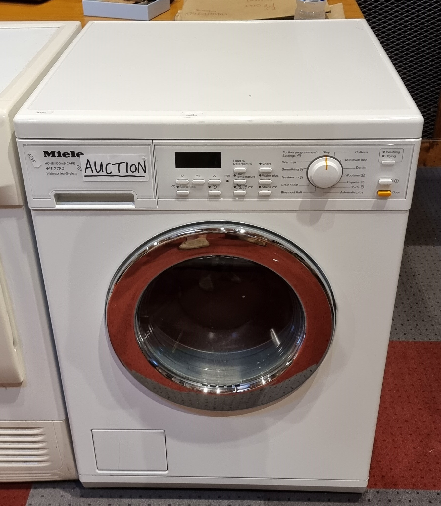 A Miele washing machine, model number WT 2780.
