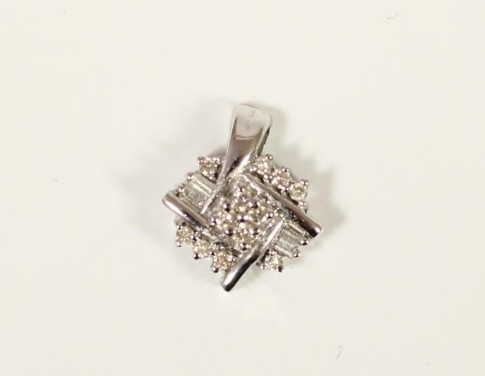 A 10k white gold and diamond pendant, set with brilliant and baguette cut stones, stated weight 0.