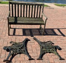 A pair of cast iron bench ends, together with a wooden garden bench (3)