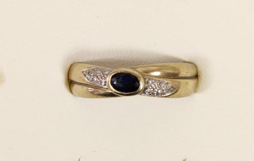 A 9ct gold sapphire and diamond dress ring, Q, 2.4gm