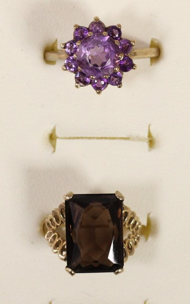 A 9ct gold and amethyst cluster ring, R and a 9ct gold and smokey quartz ring, L, 7.2gm