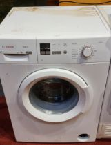 A Bosch Maxx 6 washing machine, together with a Whirlpool clothes dryer - AWZ7913, and a Sharp TV/