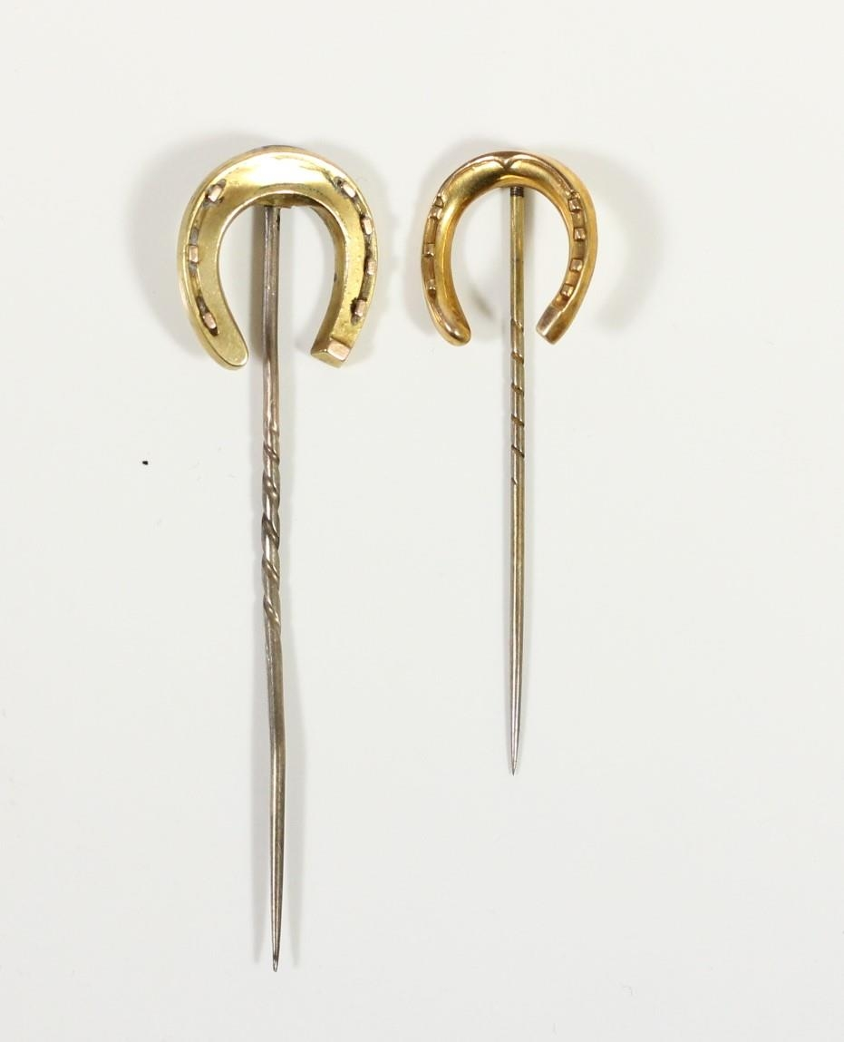 A Victorian 9ct gold horseshoe stickpin, Chester 1899 and another similar, unmarked, 3.5gm