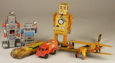 Three wind up tinplate robots together with three other tinplate models.