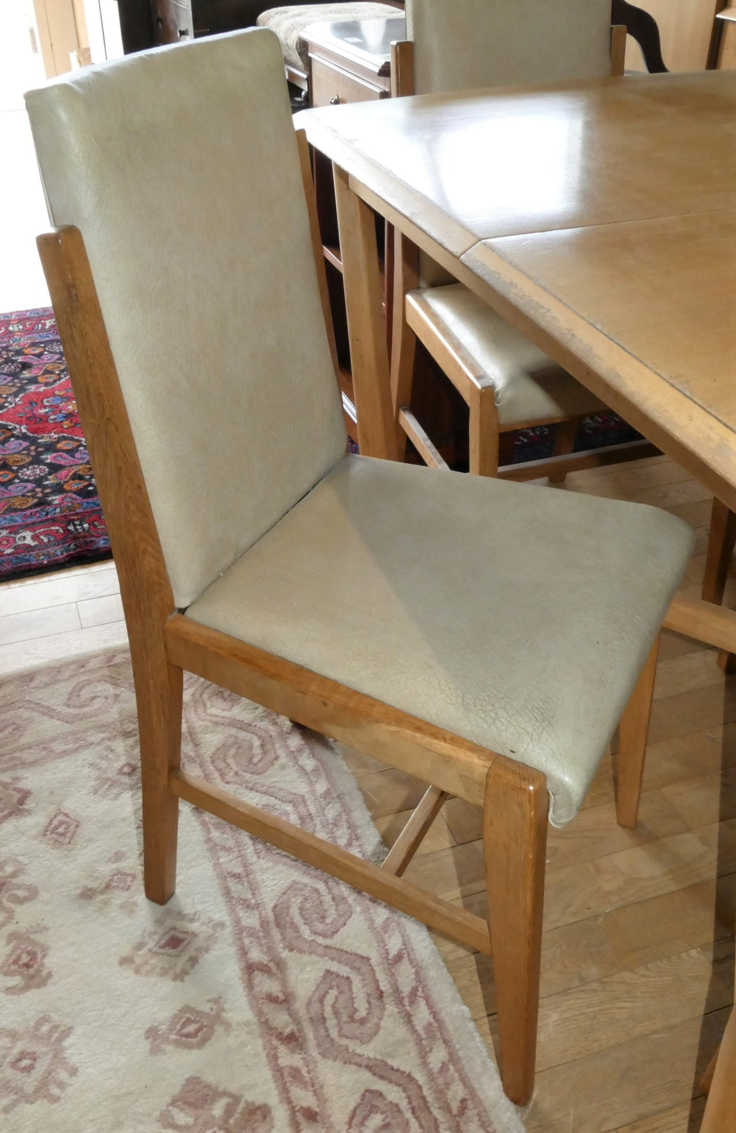 A Mid Century Deco style teak dining suite comprising of a extending dining table with integral leaf - Image 2 of 2