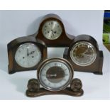A collection of clocks to include, a Smith Enfield mantel clock, together with other oak cased