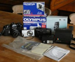 A collection of cameras to include, a 35mm Pentax 'Asami Spotmatic F' three Olympus digital cameras,