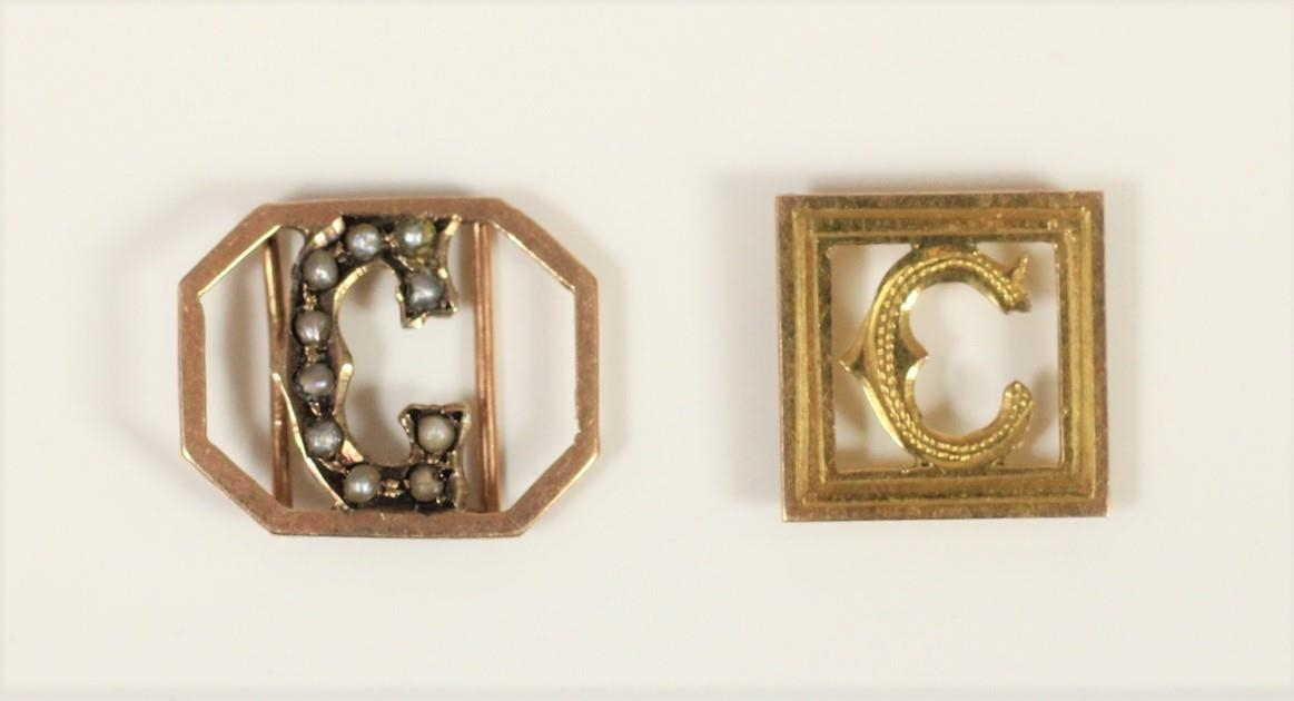 A 9ct rose gold and pearl slide initial G and another gold example, initial C, 1.2gm