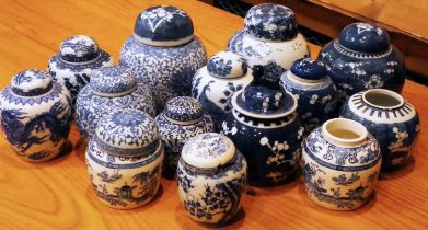 A collection of Chinese blue & white prunus ironstone ginger jars, to include Victorian and later