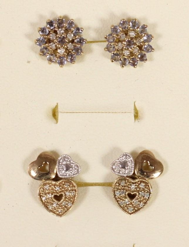 A pair of 9ct gold diamond set triple heart ear studs and another pair of diamond set ear studs, 5.