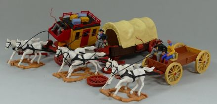 A set of three 1970's plastic models of horse drawn stage coaches by 'Timpo Toys' (3)