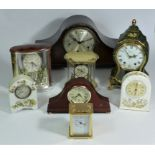 A collection of clocks to include, a Westminster England clock face, an Aynsley mantel clock, a
