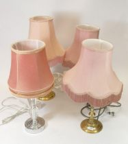 A pair of brass table lamps together with two others. (4)