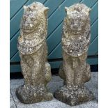 A pair of composite seated lions (2)