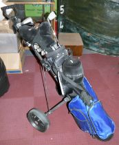 A set of twelve golf clubs by Howson, complete with golf trolley.