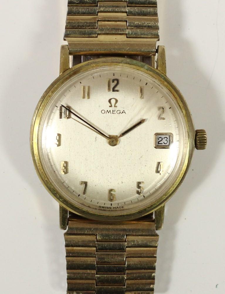 Omega, a gilt metal manual wind day gentleman's wristwatch, Arabic numerals, 34mm.