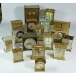 A collection of clocks to include, three lantern clock, a Seiko quartz carriage clock, together with
