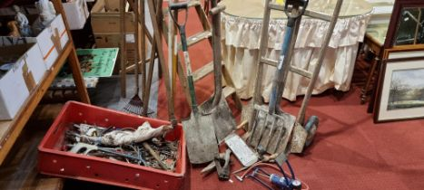 A selection of hand tools, a five step wooden ladder, sack barrow, foot pump, old garden tools.