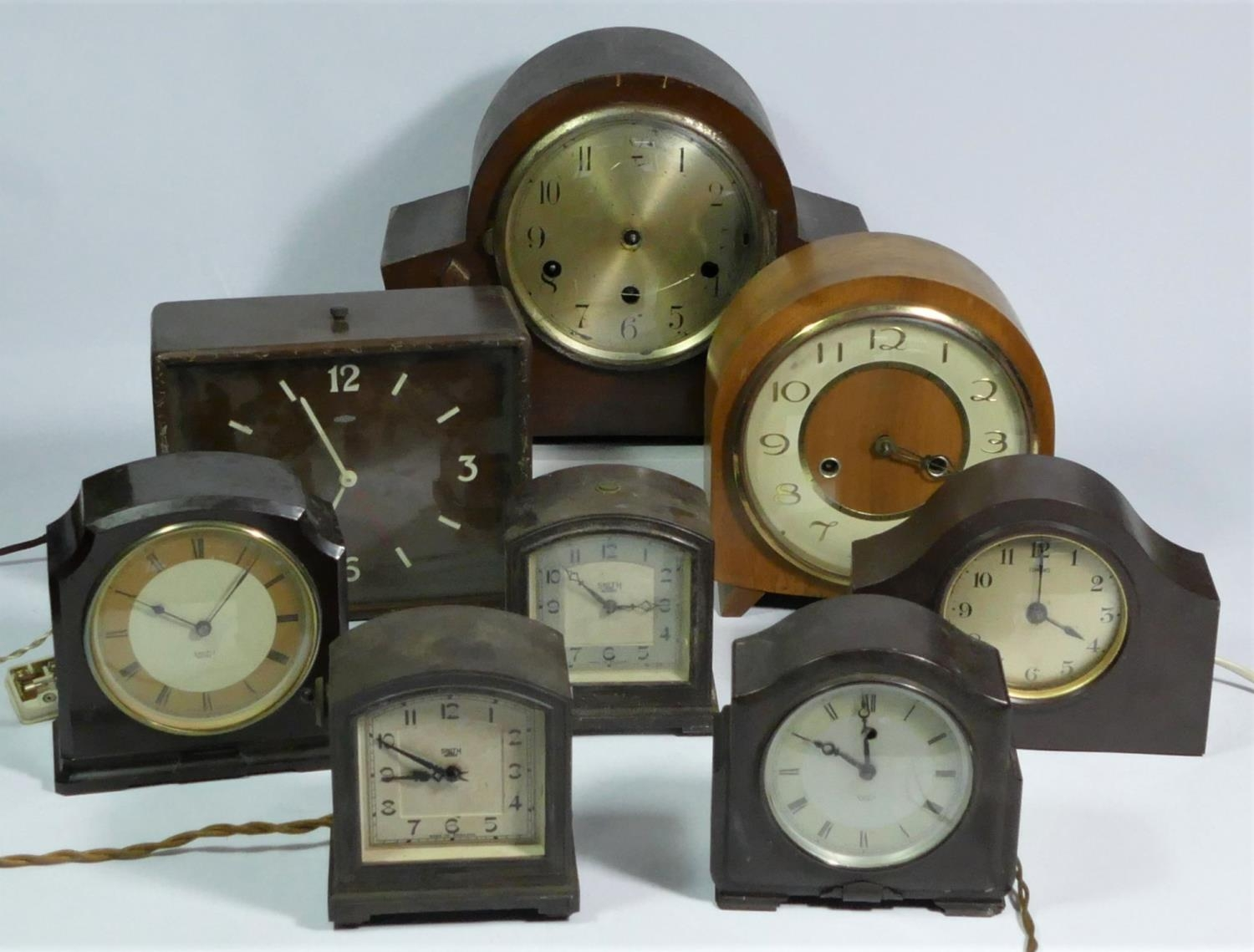 A collection of clocks to include, a Metamec electric clock, a Smiths electric clock, together
