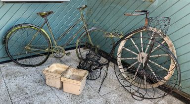 A collection of garden decoration including a early Triumph ladies bicycle, a penny farthing