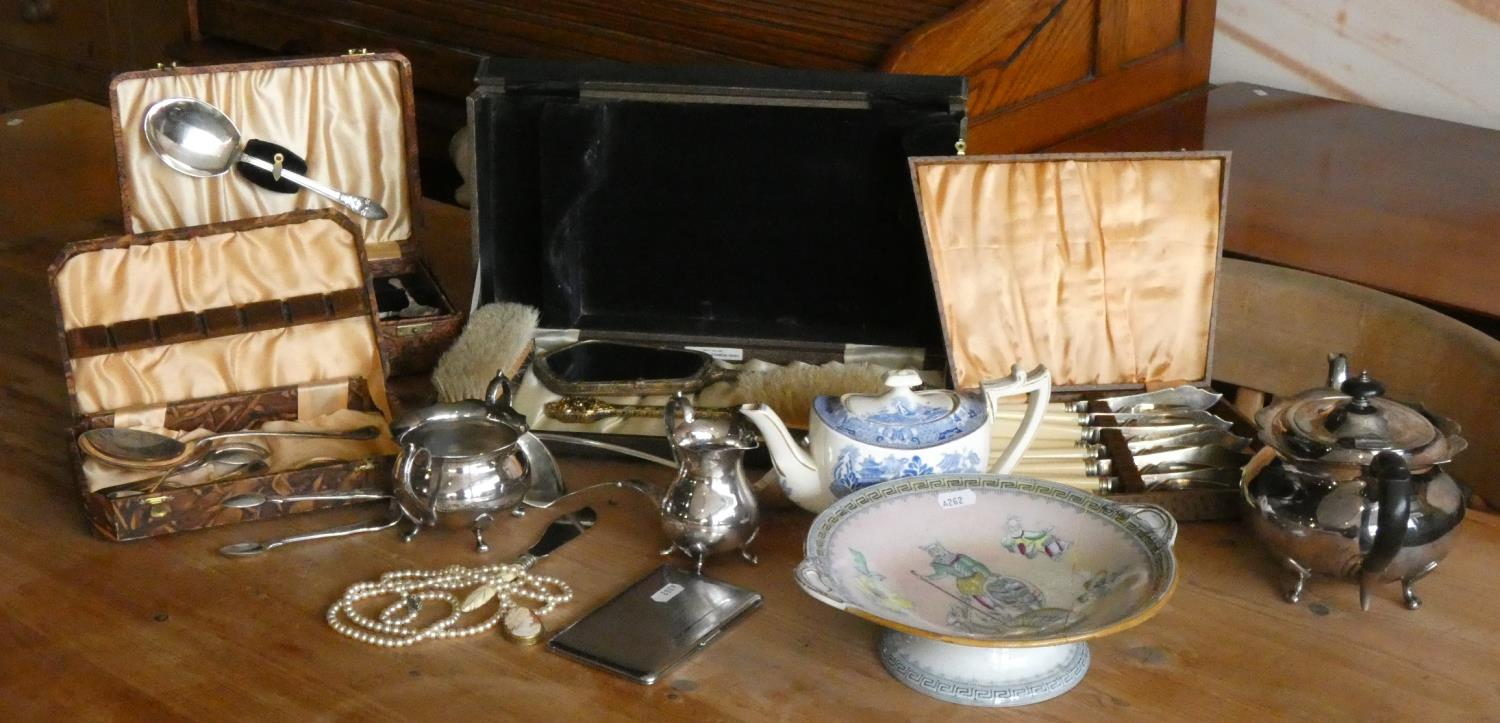 A three piece plated tea service together with cased & loose cutlery, a cased dressing table set, an