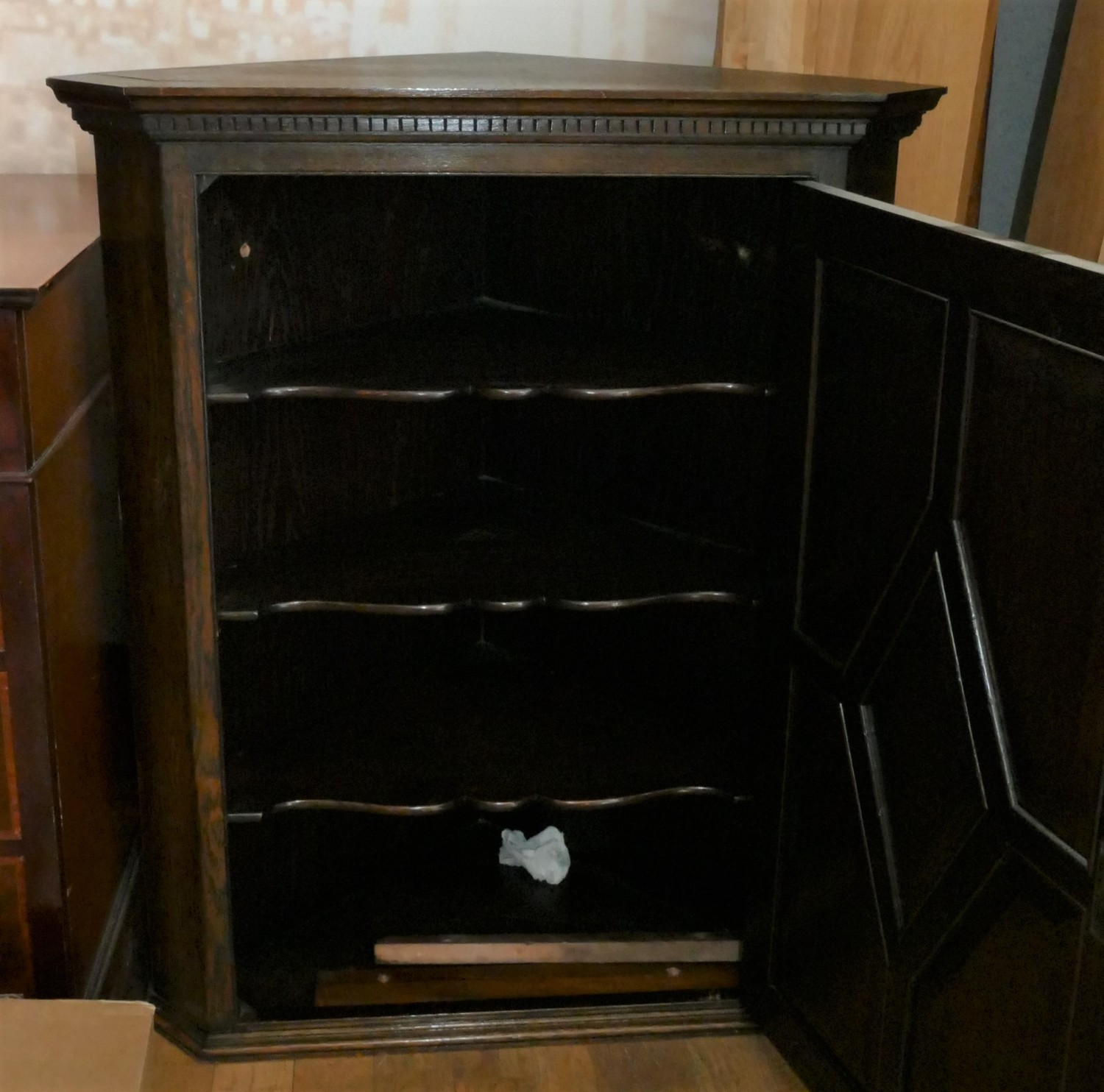 A late 19th early 20th Century carved oak corner cabinet. The four panel fielded feature door, opens - Image 2 of 2