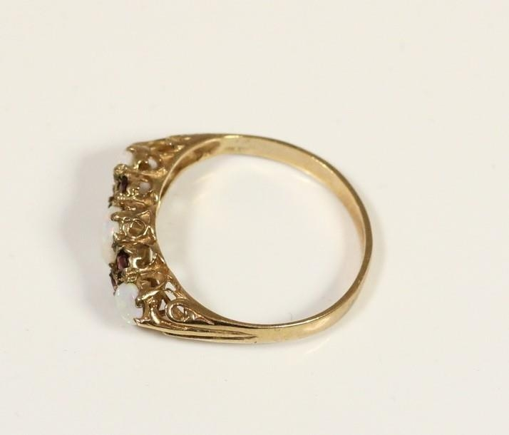 A 9ct gold opal and garnet three stone ring, Q, and a 9ct gold opal ring, N, 3gm - Image 3 of 3