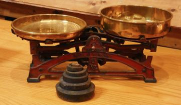 An early 20th Century set of cast metal & brass scales - stamped 'Made In Hungary' complete with a