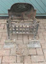 A heavy cast iron fire grate/ fire basket, complete with fireside dogs. Would make an ideal garden
