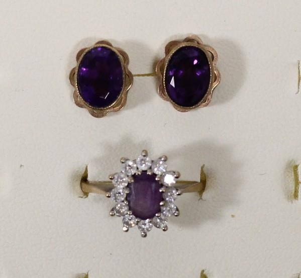 A 9ct gold amethyst and white stone cluster ring, P and a pair of amethyst ear studs, 5.2gm