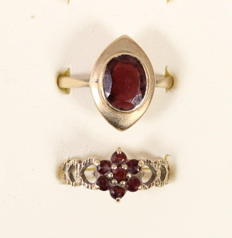 A 9ct gold garnet panel ring R and a 9ct gold garnet cluster ring, N, 5.2gm