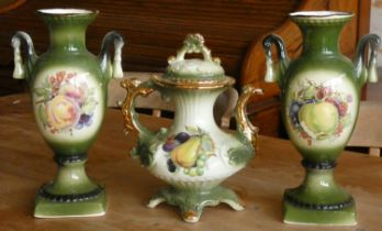 A three piece 'Green Fruit' ceramic set to include, a pair of vases & a matching teapot. (3)