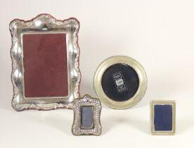 A circular silver photograph frame, Birmingham, no date letter, 11.5cm diameter, two small silver