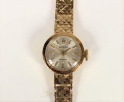 Rolex, a 9ct gold manual wind ladies wristwatch, London 1966, the silvered dial with baton markings,