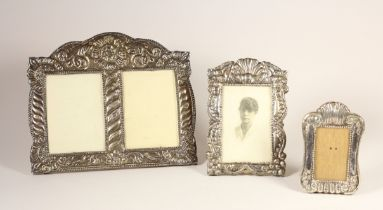 A silver mounted double photograph frame, stamped 925, with embossed decoration, 22 x 27cm and two