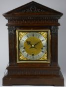 A Winterhalder & Hofmeier oak musical repeating bracket clock, with a silvered chapter ring and gilt