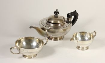 A silver three piece bachelor tea service, by Barker Bros, Chester 1919/21, of circular form with
