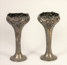 An Edwardian Art Nouveau silver pair of flower vases, Birmingham 1903, with embossed and chased