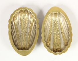 A pair of silver and gilt shell dishes, stamped SILVER, with embossed decoration, 11.5 x 7.5cm, 2.