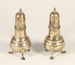 A silver pair of castors, London 1946, of baluster form, raised on three pad feet, 13.5cm, 7.5oz.