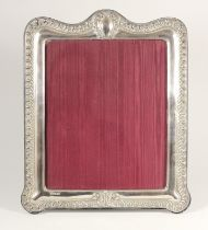 A silver mounted photograph frame, London 1997, with embossed gadrooned border, 33 x 28cm overall.